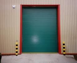 Green roller shutter warehouse door
